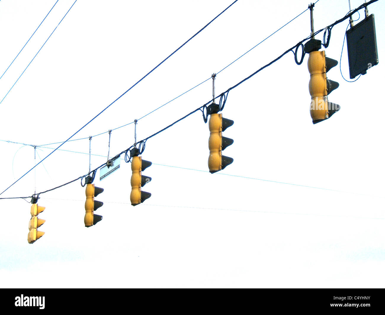 A hanging section of traffic lights and wires. - Stock Image