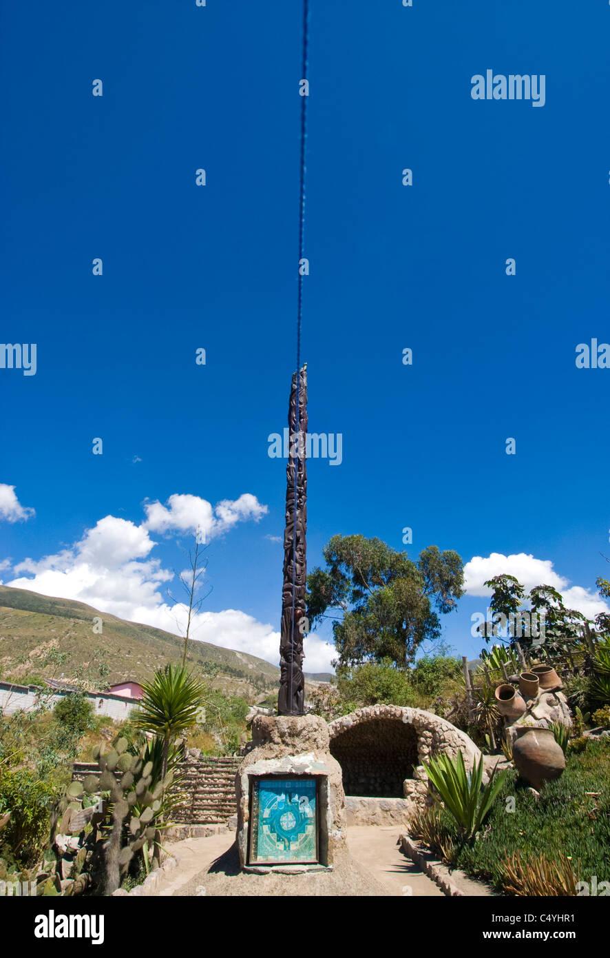 Equator monument near Quito Ecuador; vertical line is right over the equator - Stock Image