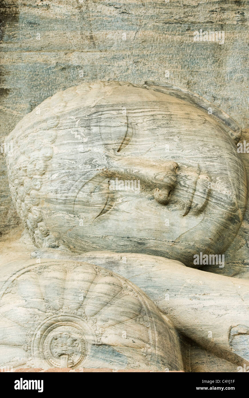 Face of Reclining Buddha, Gal Vihara, Polonnaruwa, Sri Lanka WORLD HERITAGE SITE. Stock Photo
