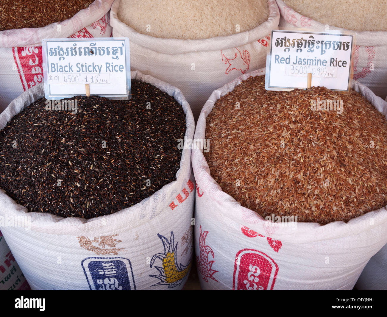Sacks of black sticky rice and red jasmine rice for sale at the Old Market, Siem Reap, Cambodia - Stock Image