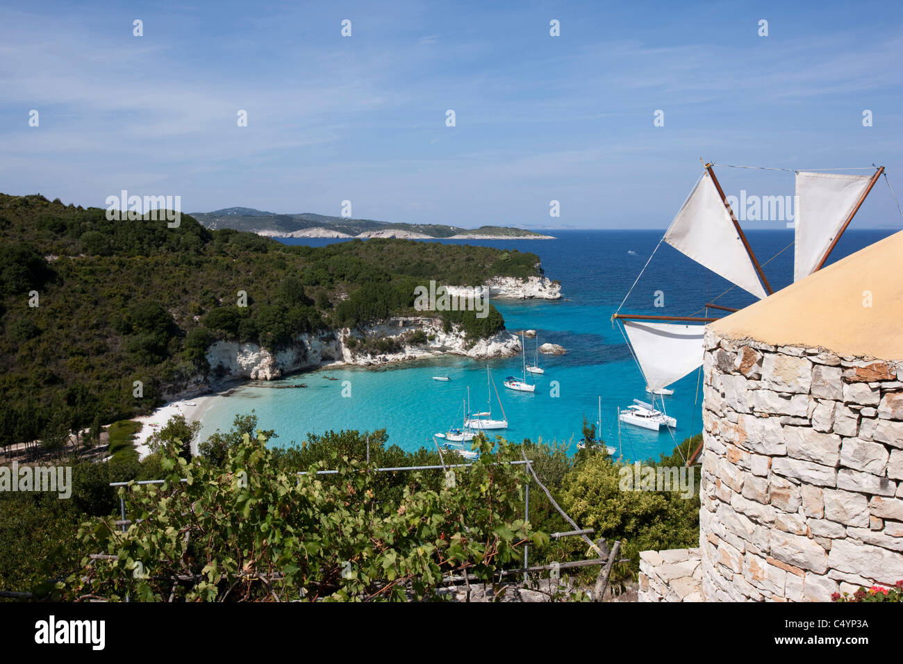 The windmill above Voutoumi bay. AntiPaxos, Greece. - Stock Image
