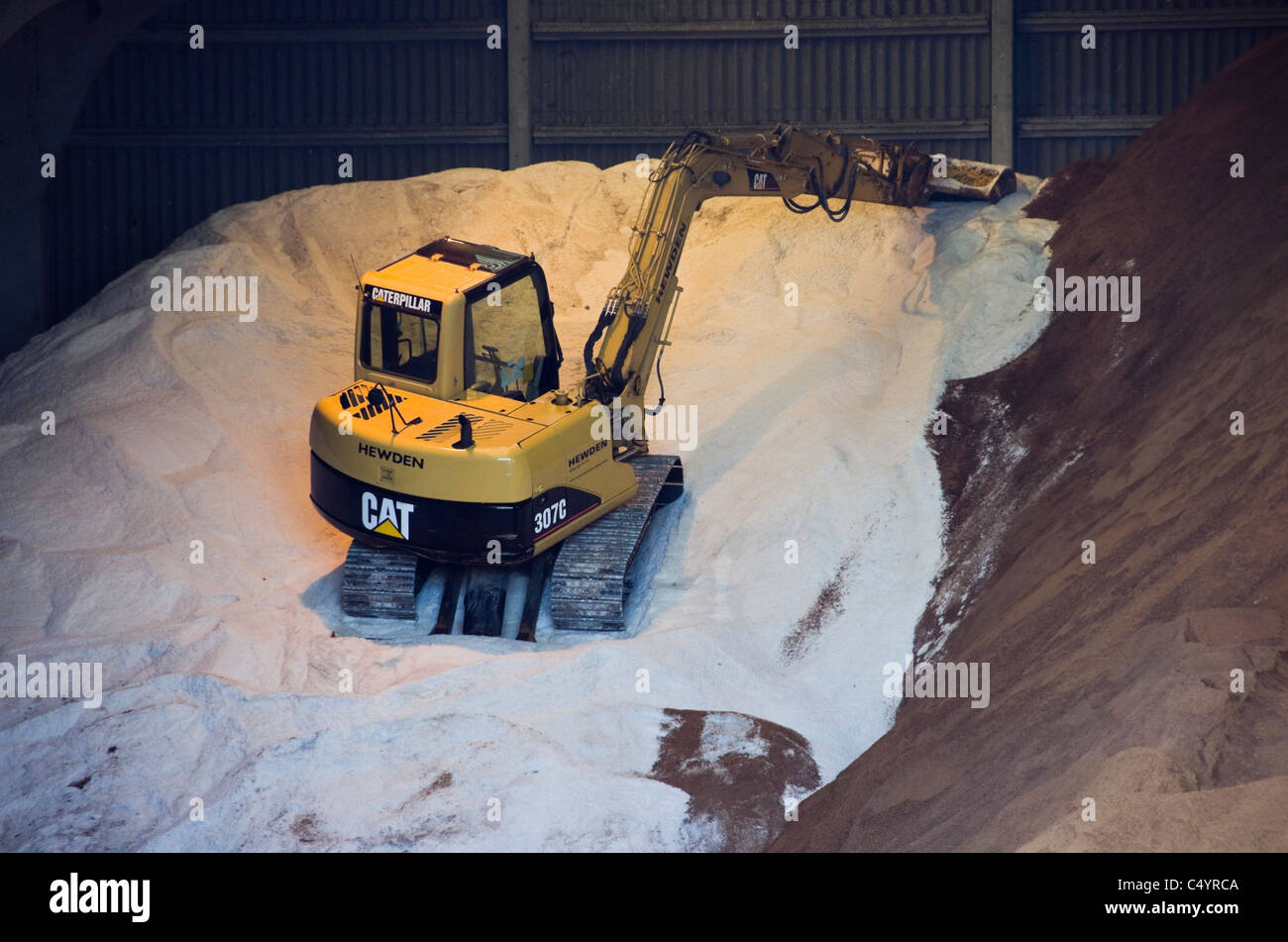 UK. Road salt and grit supplies stored in County Council depot for cold winter weather. - Stock Image