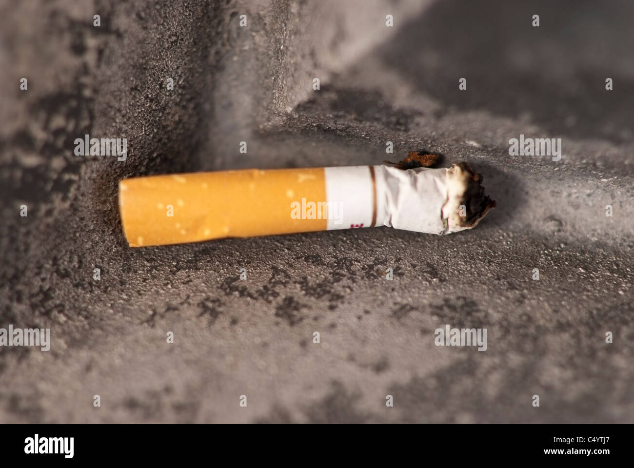 A smoked cigarette. - Stock Image