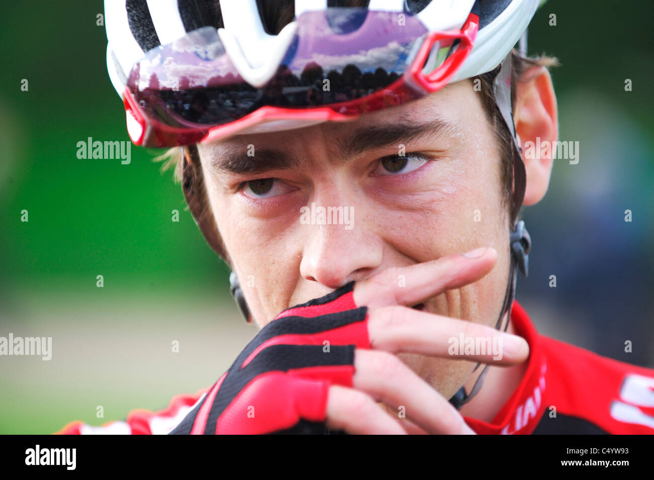 Pro cyclist Tom Minty Murray cries after a wonderful solo ride - Stock Image