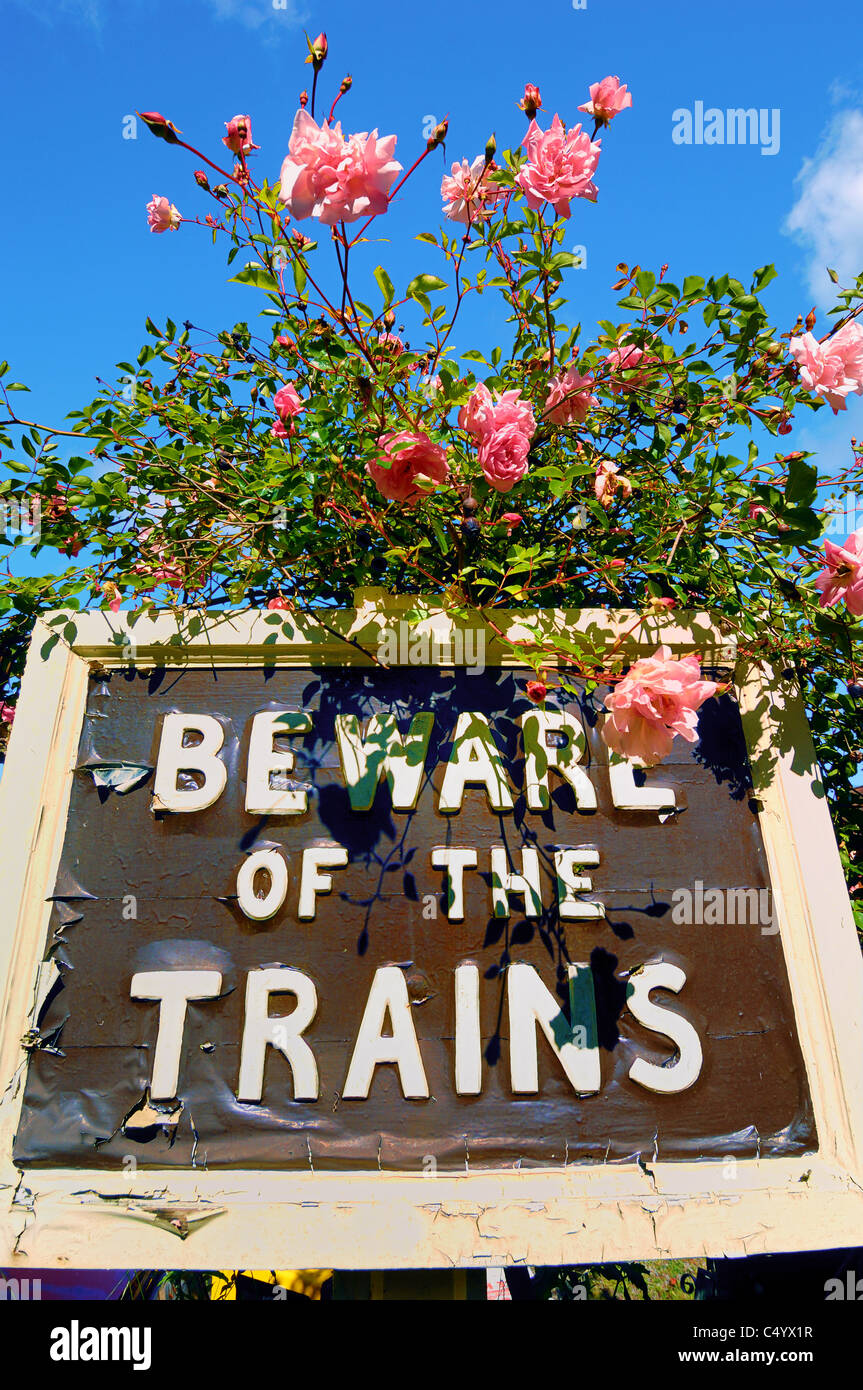 Warning sign at the Old Railway Station, now closed, at the village of Limpley Stoke, near the City of Bath, Somerset, - Stock Image