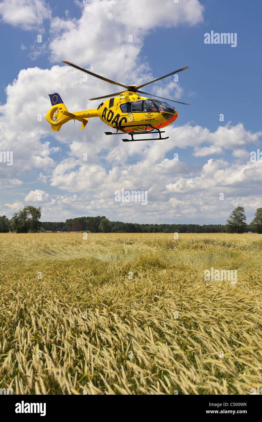 German ADAC Rescue Helicopter in a corn Field Stock Photo