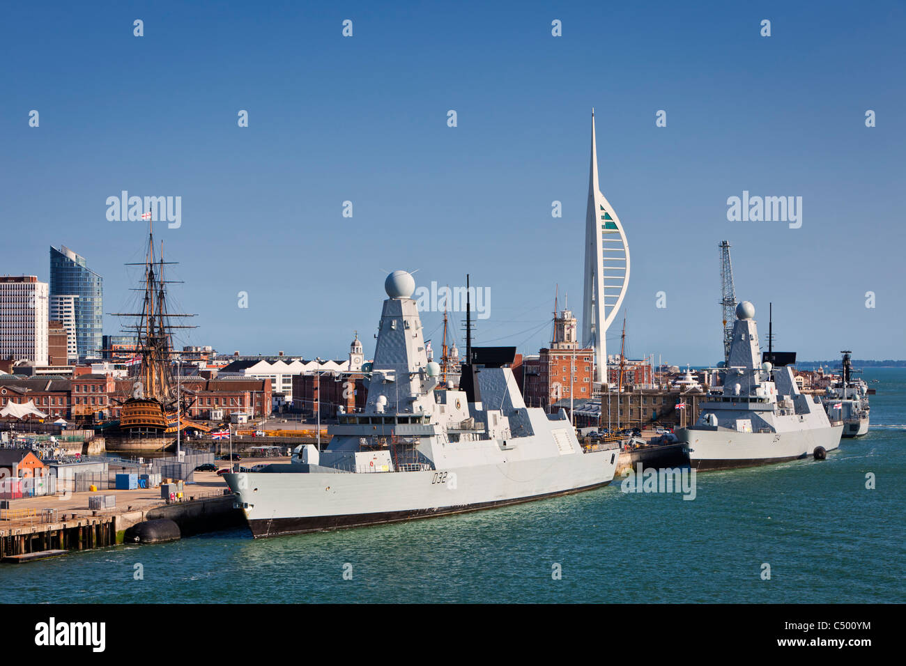 Portsmouth Harbour, England UK, modern and historic Navy warships - Stock Image