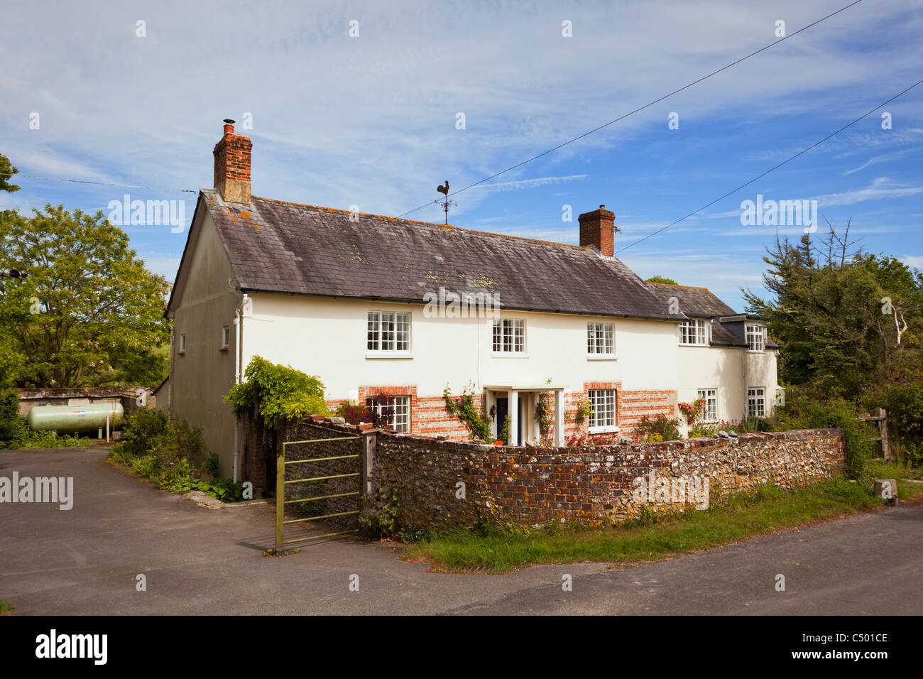 Old English country house cottage in village of Tarrant Monkton, Dorset, England, UK - Stock Image
