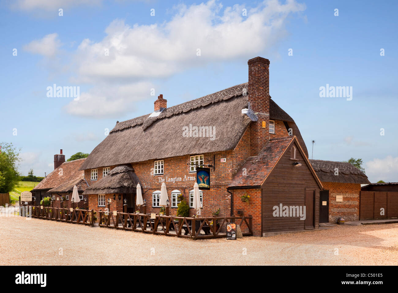 The Langton Arms thatched tavern village pub in Tarrant Monkton, Dorset, England, UK - Stock Image