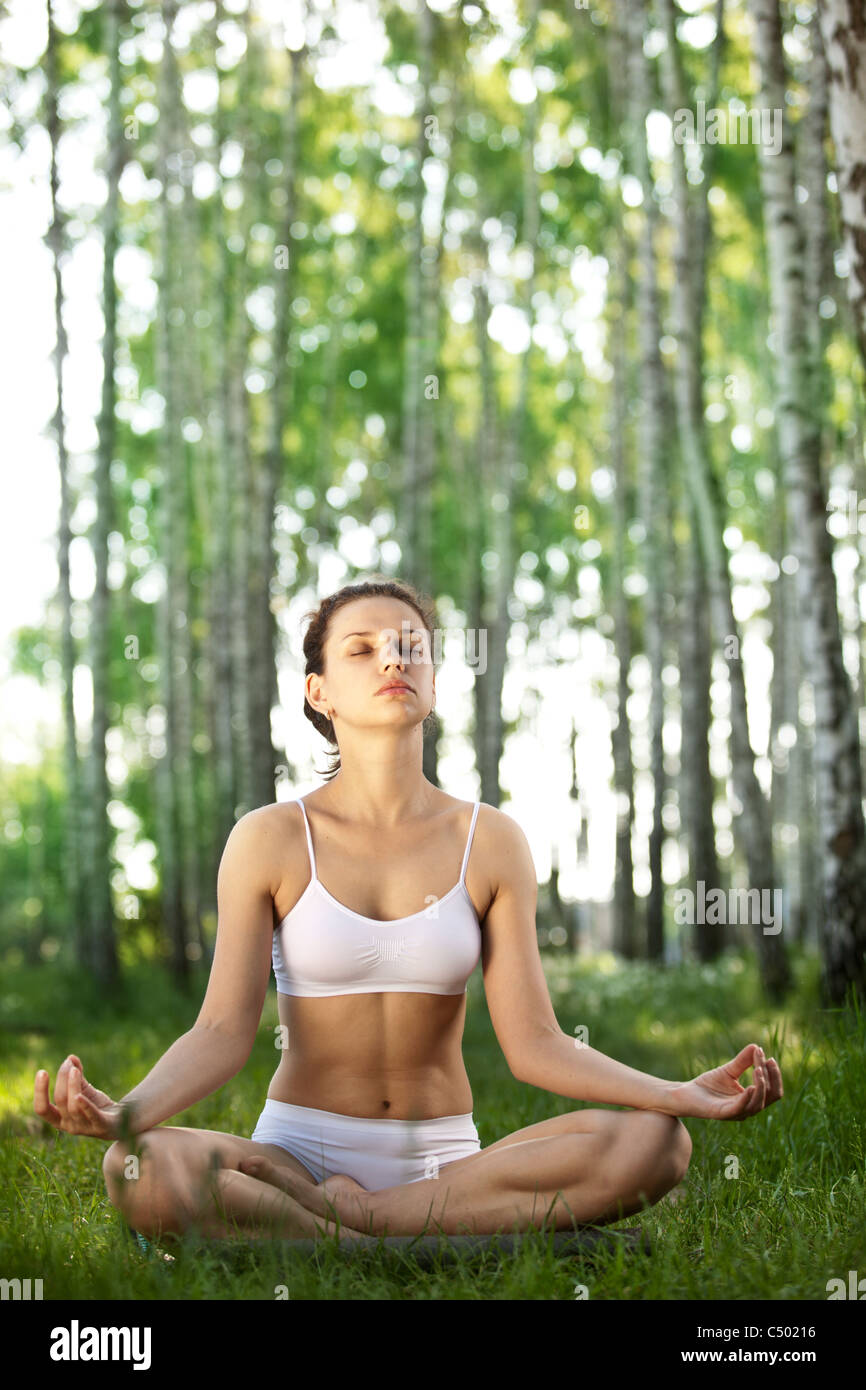 Practicing of yoga outdoors. - Stock Image