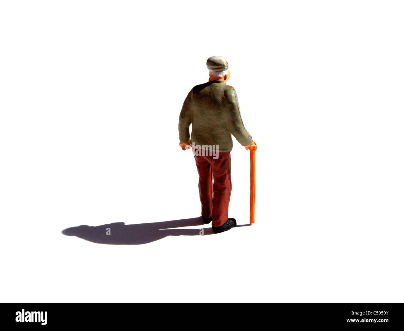 Old man figurine alone - loneliness, loss, retirement people concept - Stock Image