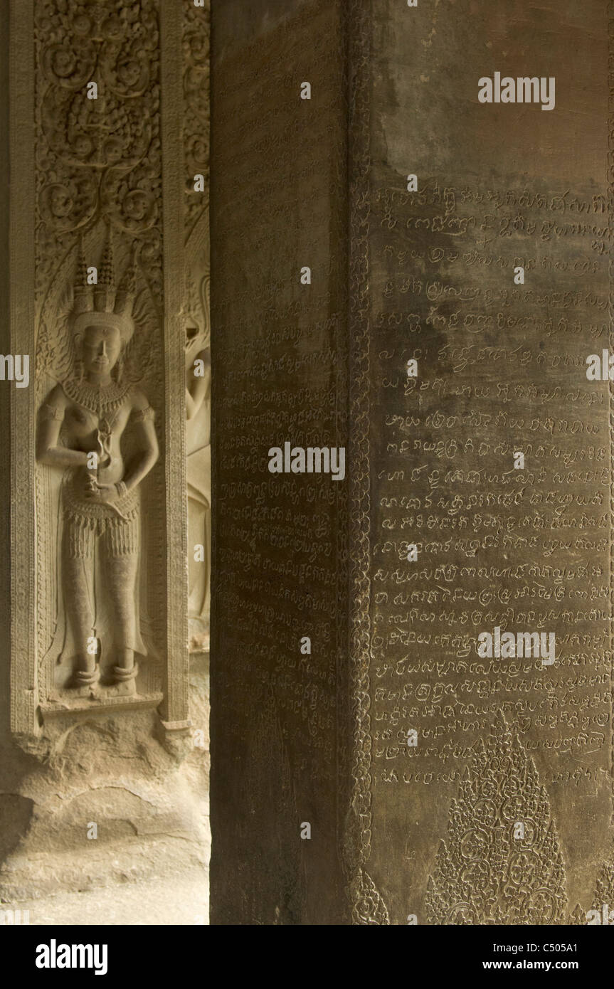 Engraved Khmer script and carved apsara in the Central Sanctuary, on the third level of Angkor Wat, Angkor, Siem - Stock Image