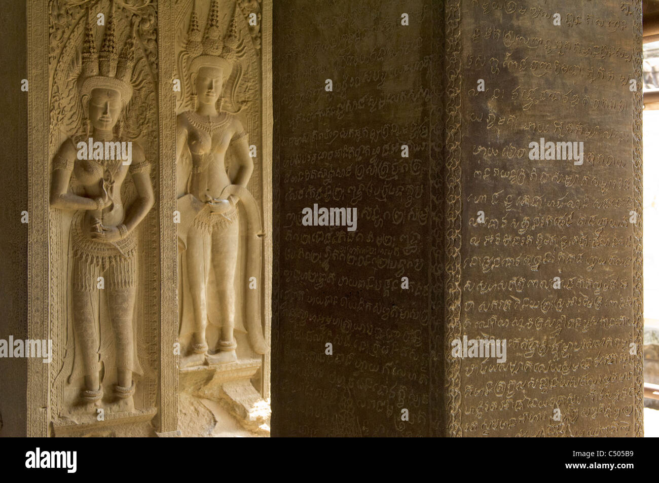 Engraved Khmer script and carved apsaras in the Central Sanctuary, on the third level of Angkor Wat, Angkor, Siem - Stock Image
