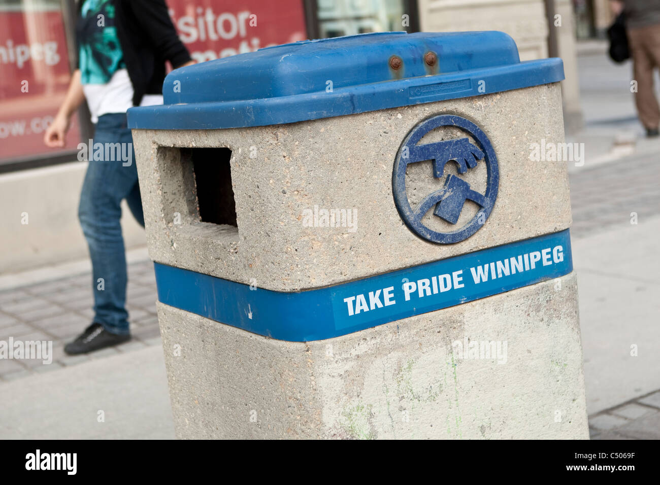 A street garbage can is pictured on Portage avenue in Winnipeg Sunday May 22, 2011. - Stock Image