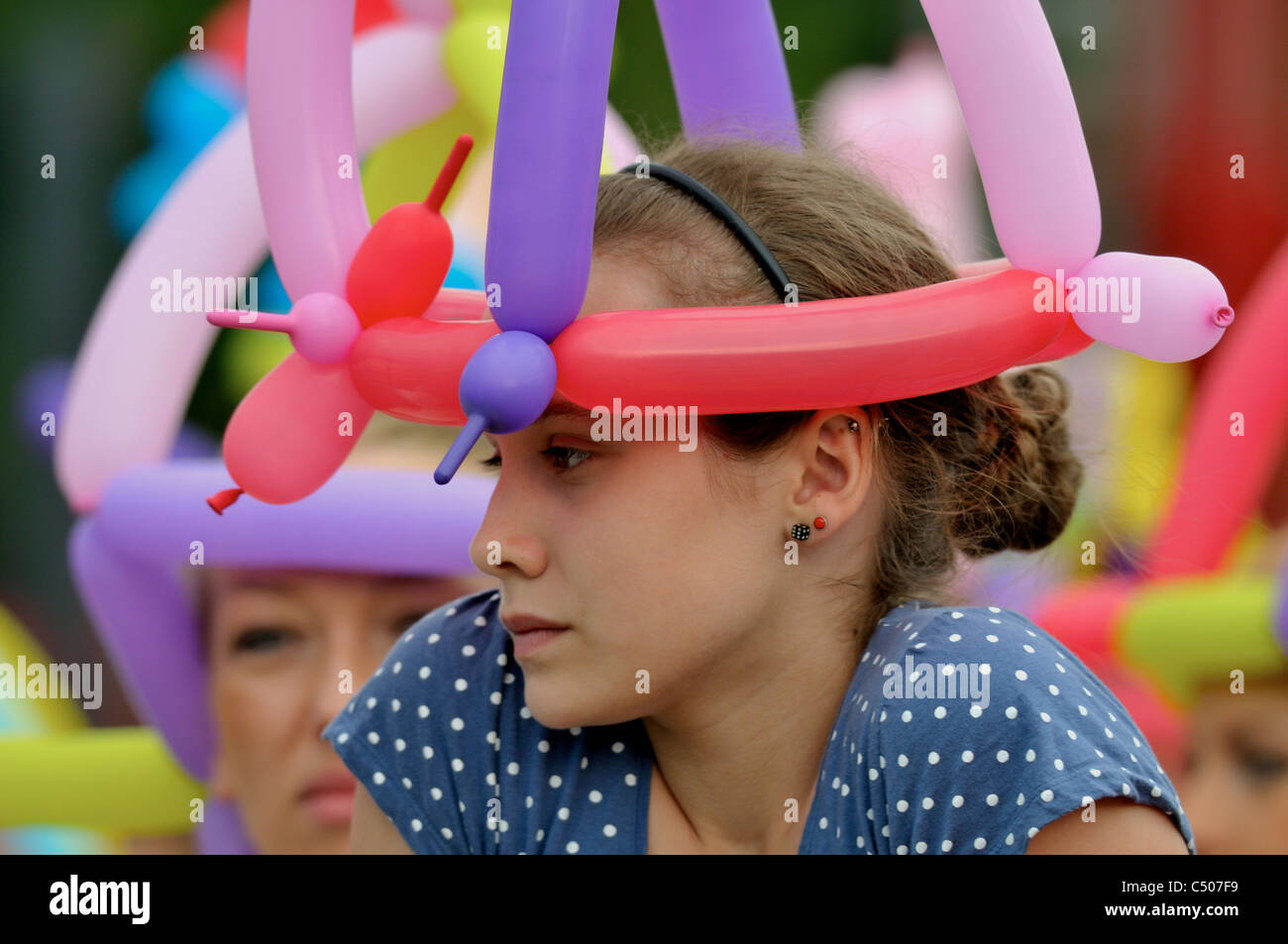 Young girl at the fun fair - Stock Image