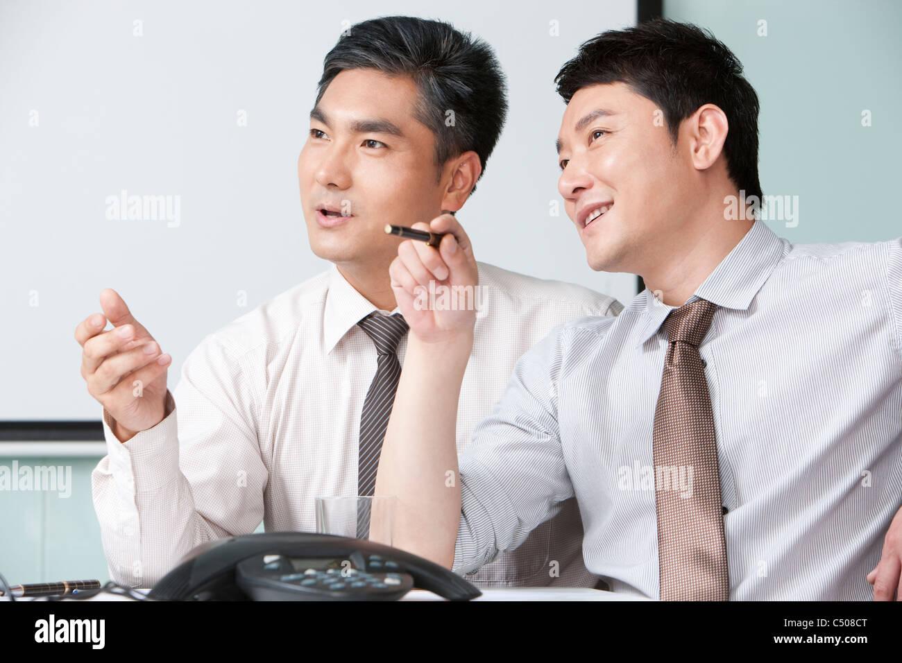 Businessmen Deliberating - Stock Image