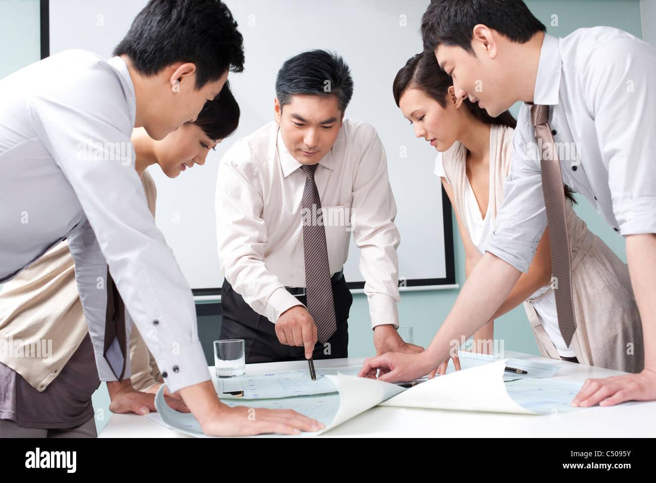 Business Executive Explaining Business Plan to Business Team - Stock Image