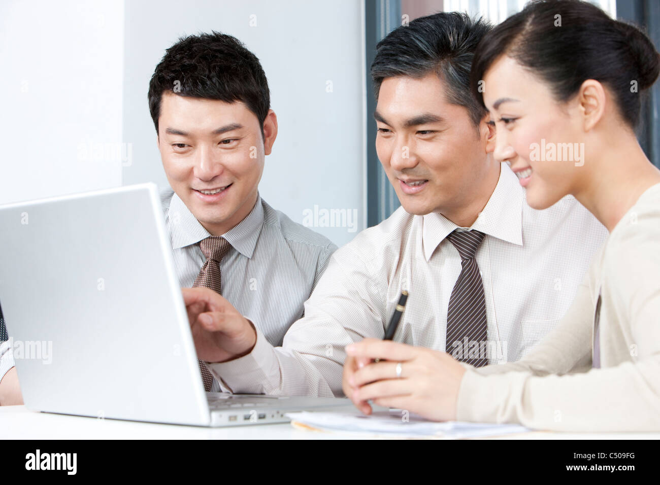 Business Executive Explaining to Younger Businesspeople - Stock Image