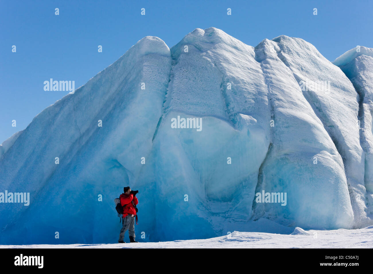 Tourist photographing iceberg, Snow Hill Island, Antarctica Stock Photo