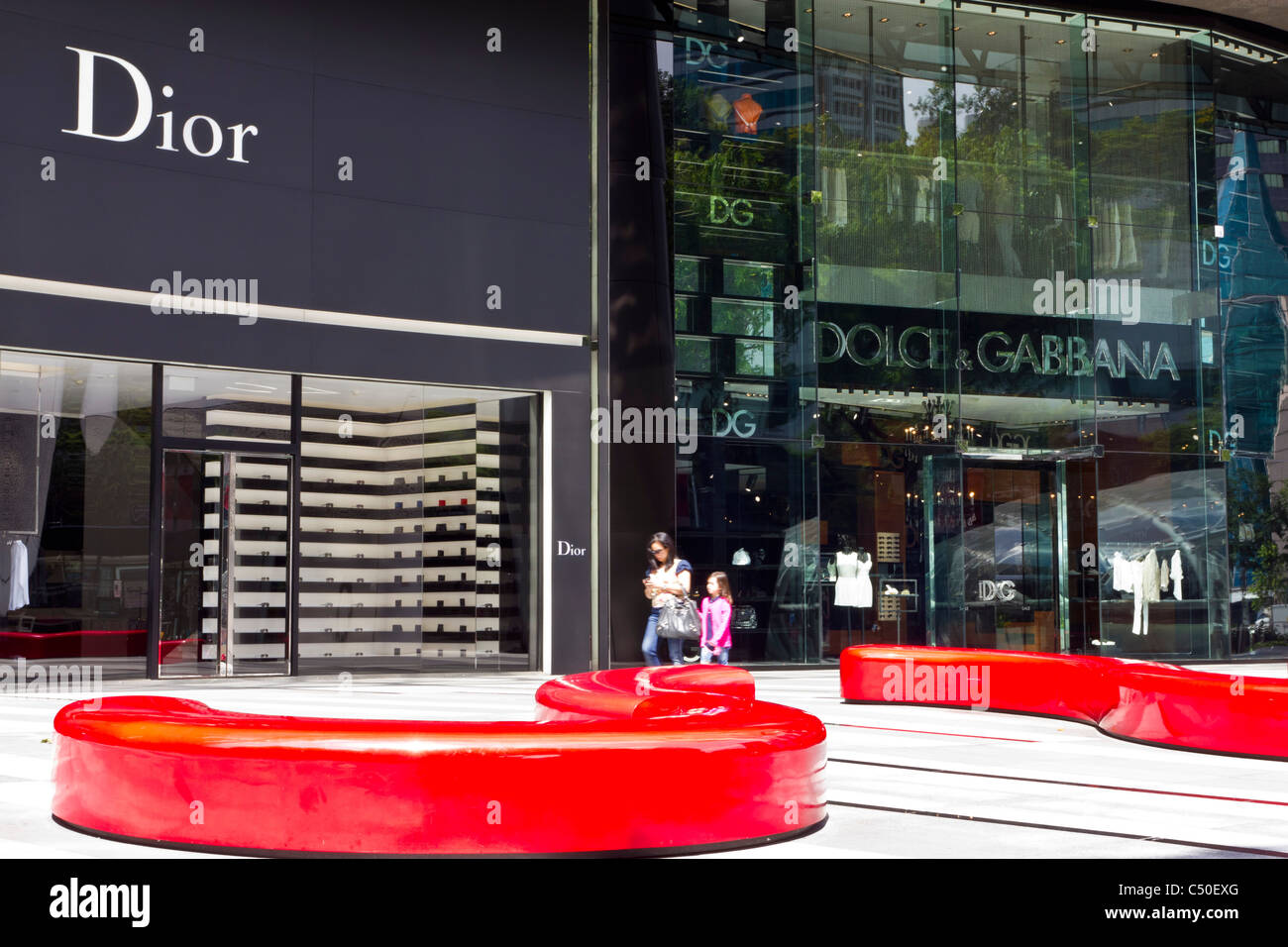 Dior and Dolce & Gabbana shops in Singapore's ION Shopping Centre - Stock Image