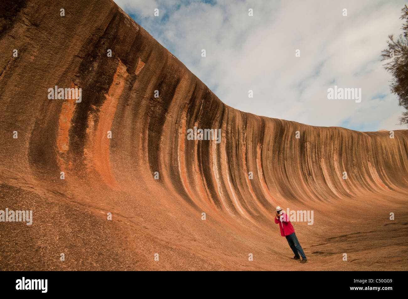 Photographing Wave Rock a natural geological formation near Hyden in Westen Australia - Stock Image