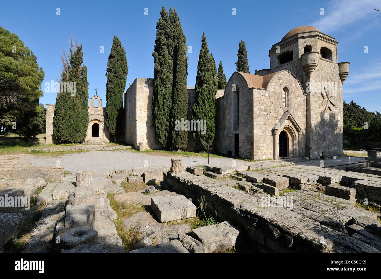 Rhodes. Greece. Monastery of the Virgin aka Monastery Panagia Filerimos, and remains of the ancient Temple of Athena - Stock Image