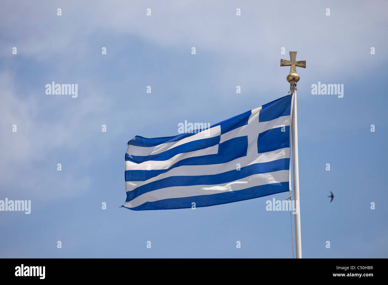 greek flag in the coastal port city Volos in Thessaly on the Greek mainland, Greece - Stock Image