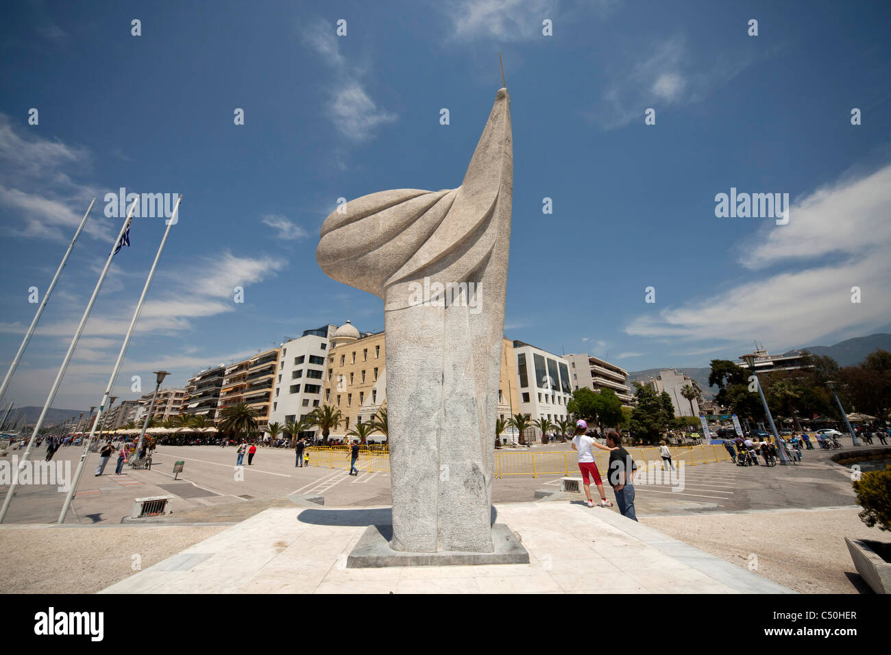 monument at the marina of the coastal port city Volos in Thessaly on the Greek mainland, Greece - Stock Image