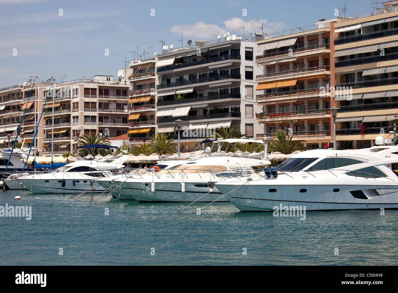 Yachts at the harbour of the coastal port city Volos in Thessaly on the Greek mainland, Greece - Stock Image