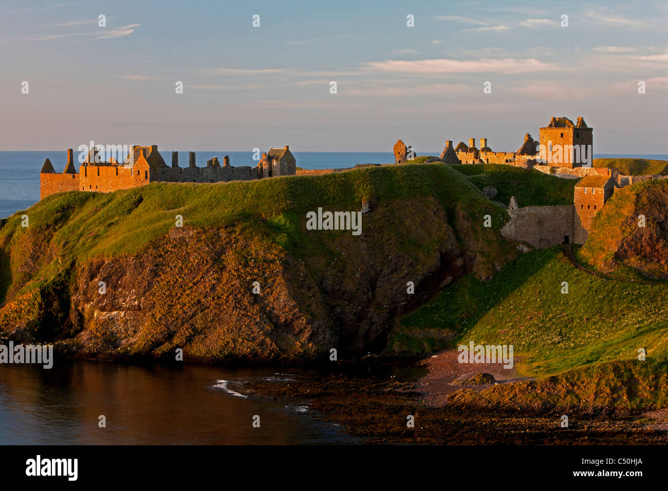A view looking down onto Dunnottar Castle in the morning light, near Stonehaven, Aberdeenshire, Scotland - Stock Image