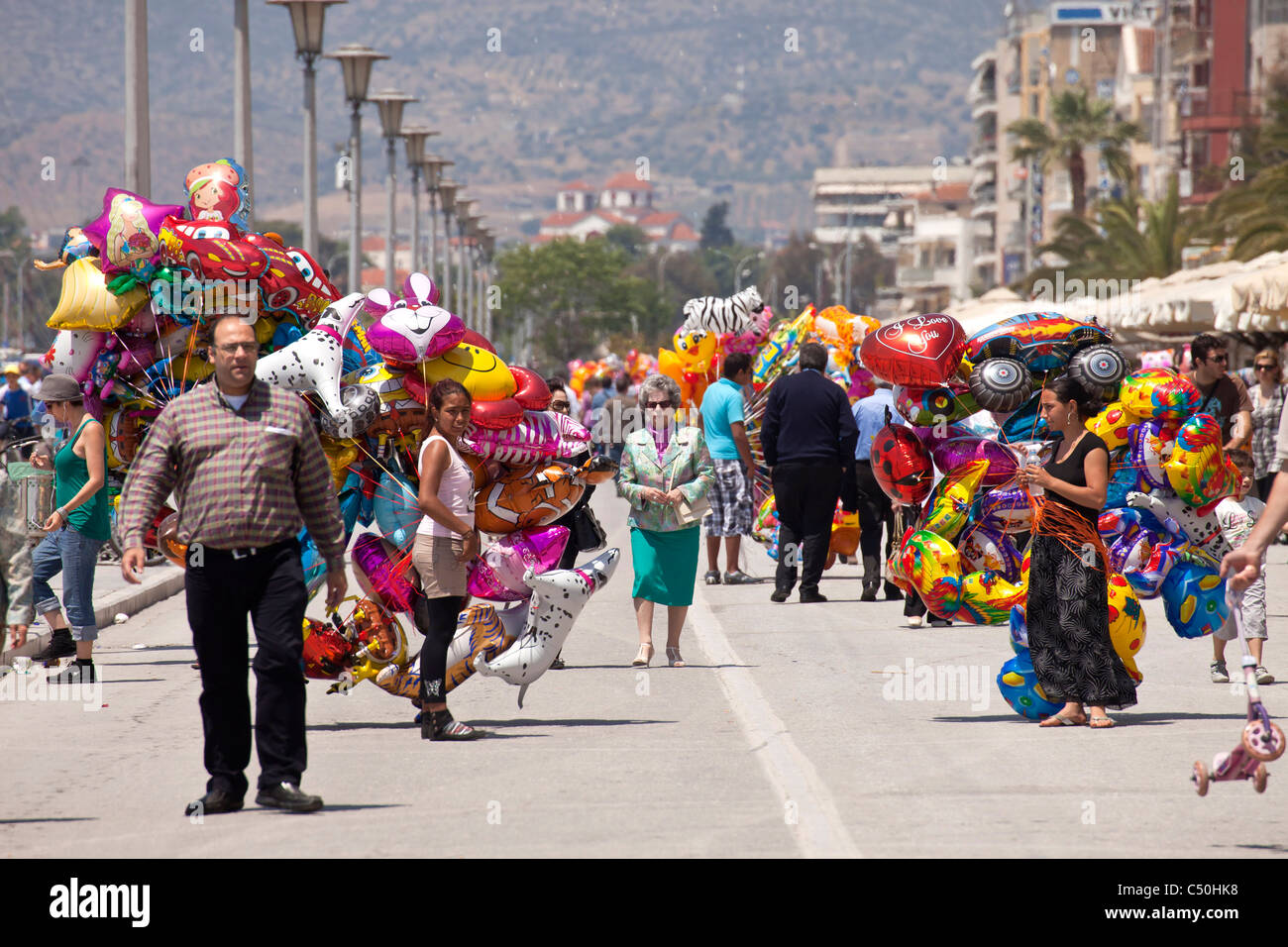 balloon vendor on the harbour promenade of the coastal port city Volos, Thessaly, Greece - Stock Image