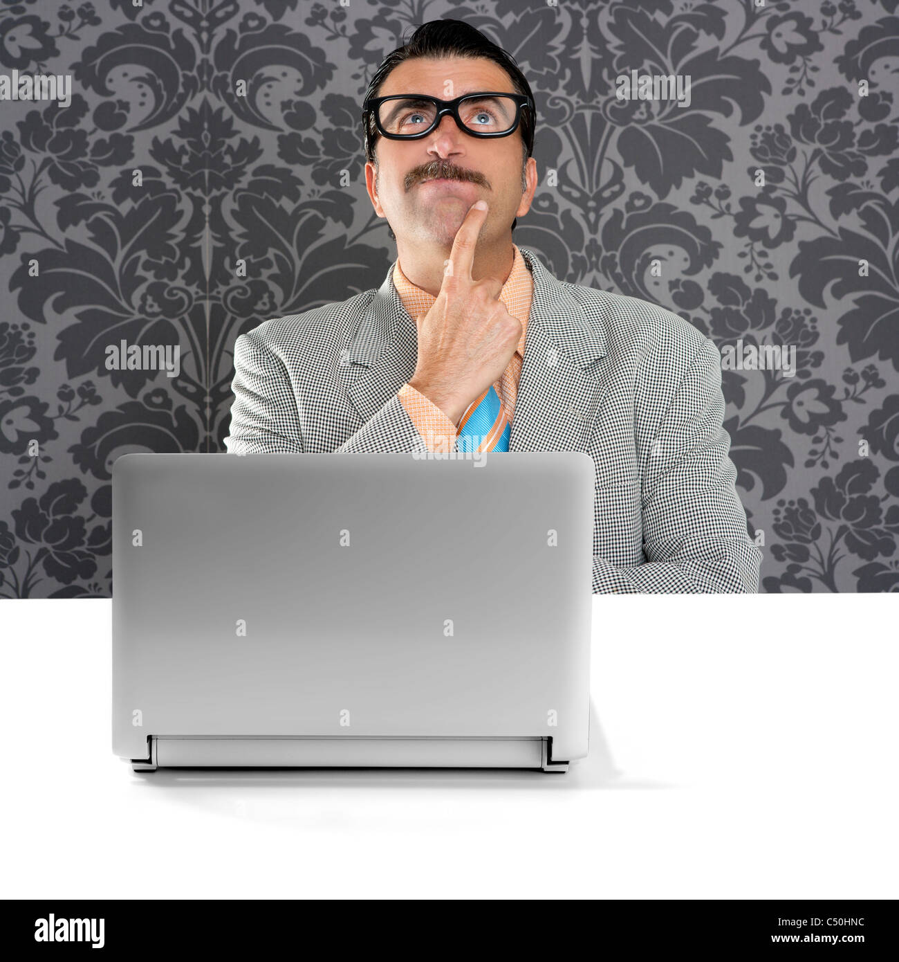 genius nerd silly glasses computer thinking gesture problem solution wallpaper background Stock Photo