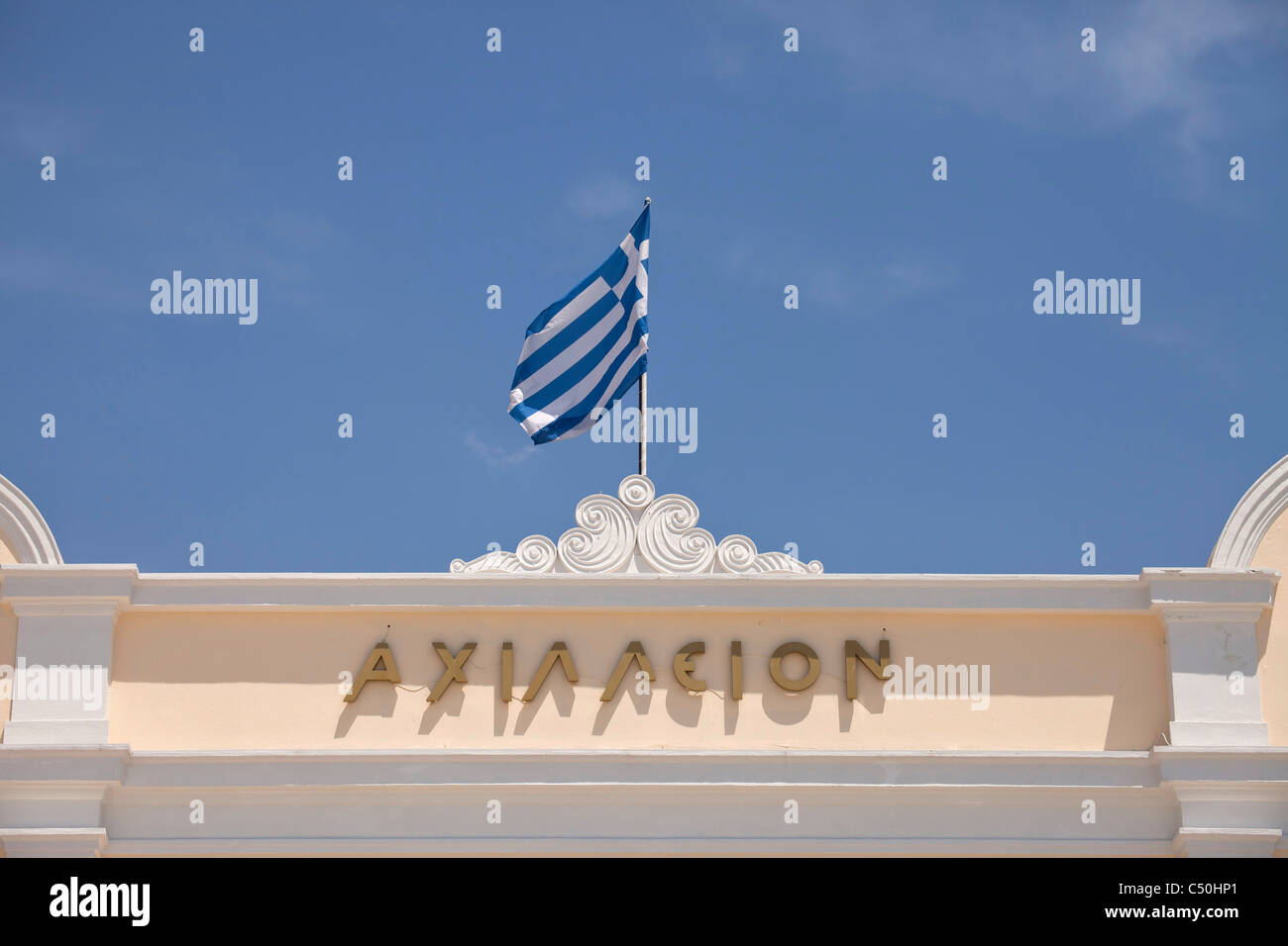 greek flag on a roof in the coastal port city Volos in Thessaly on the Greek mainland, Greece - Stock Image