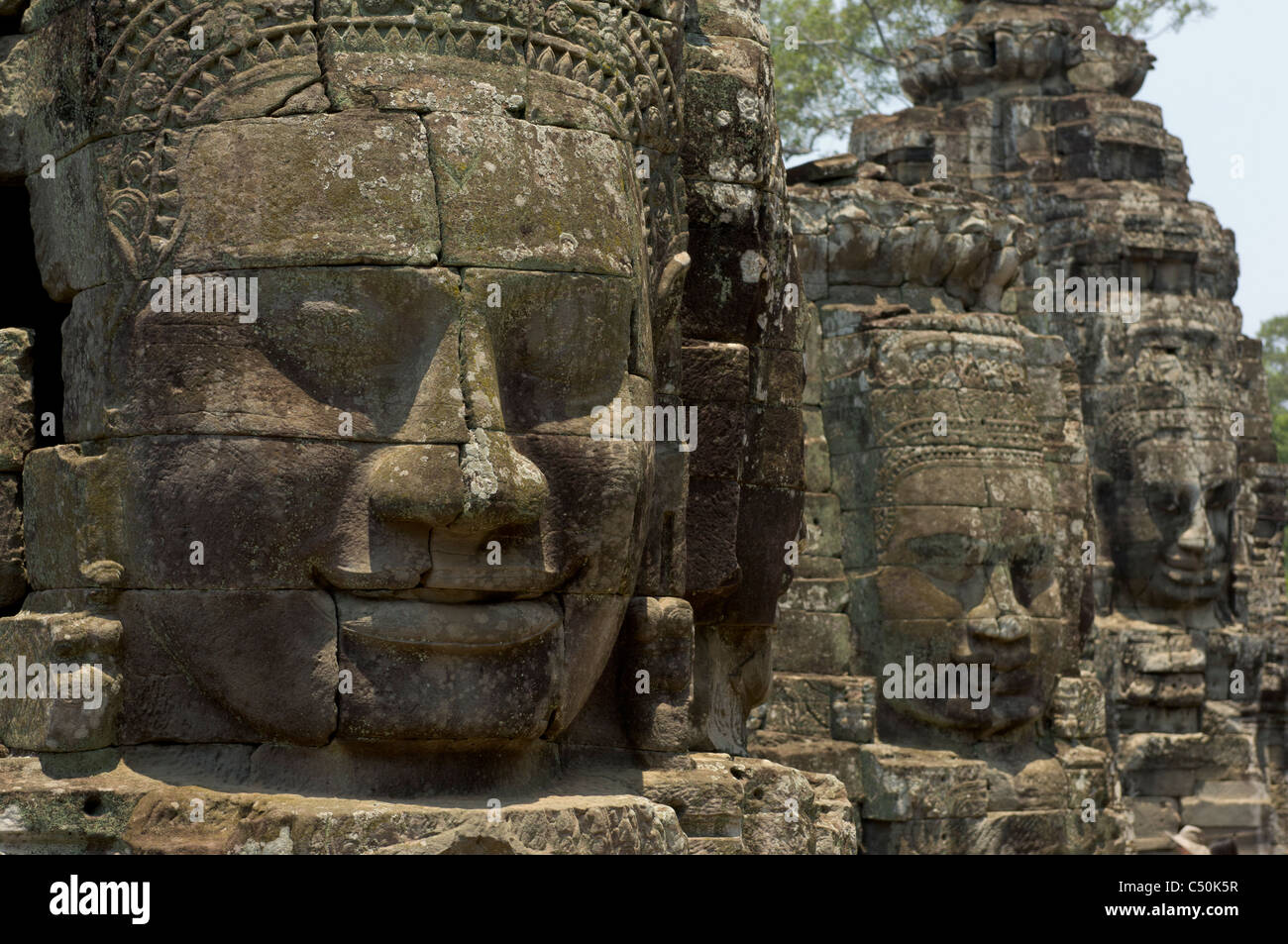 Enigmatic stone carved faces of The Bayon, Angkor Thom complex, Angkor, Siem Reap, Cambodia Stock Photo
