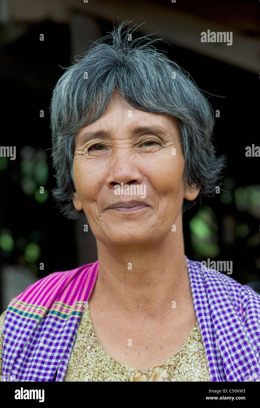 Cambodian woman, with greying hair wearing a krama, Kompong Klang, on the shore of Tonle Sap lake, near Siem Reap, - Stock Image