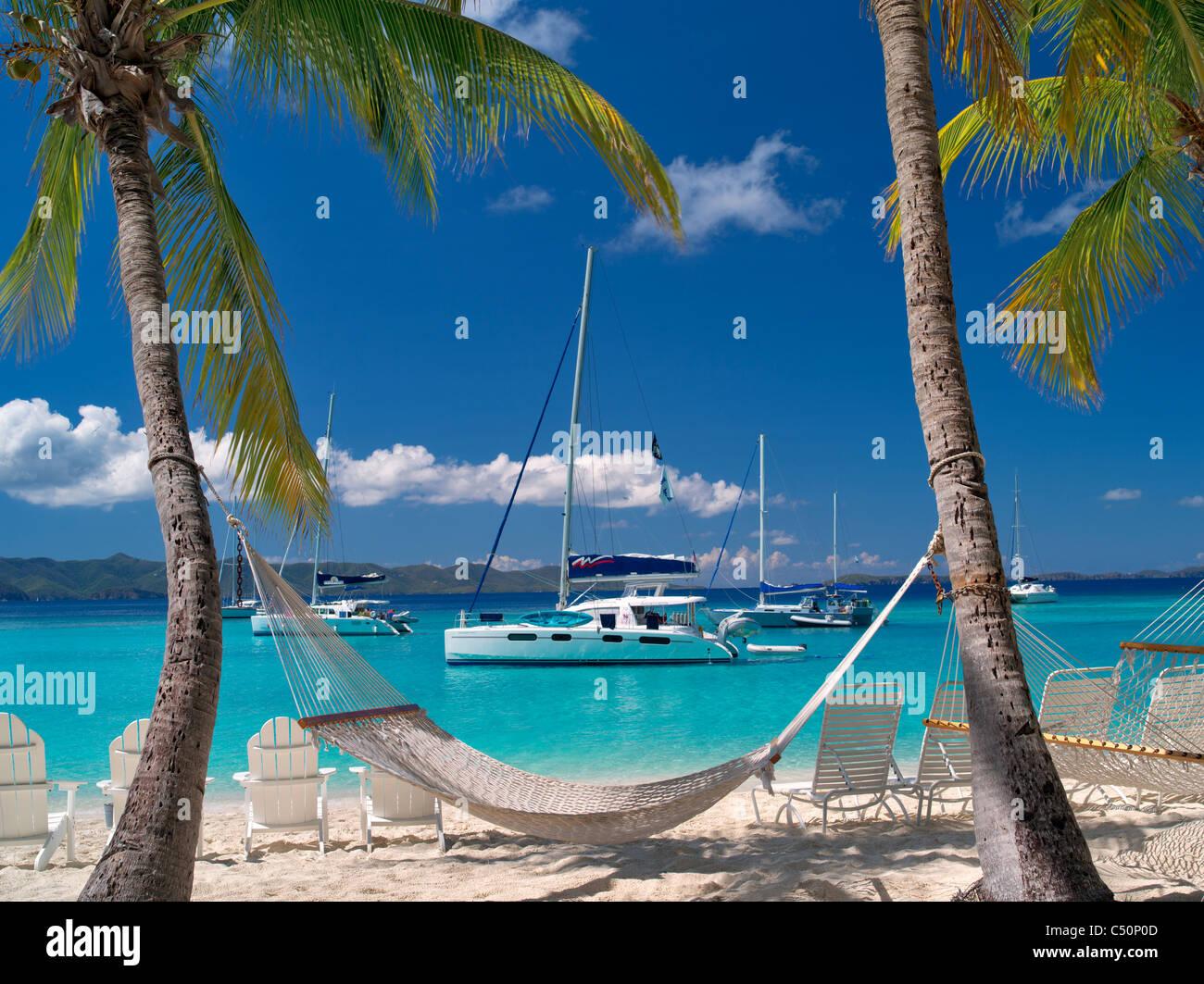 Boats and hammock at Jost Van Dyke. British Virgin Islands - Stock Image