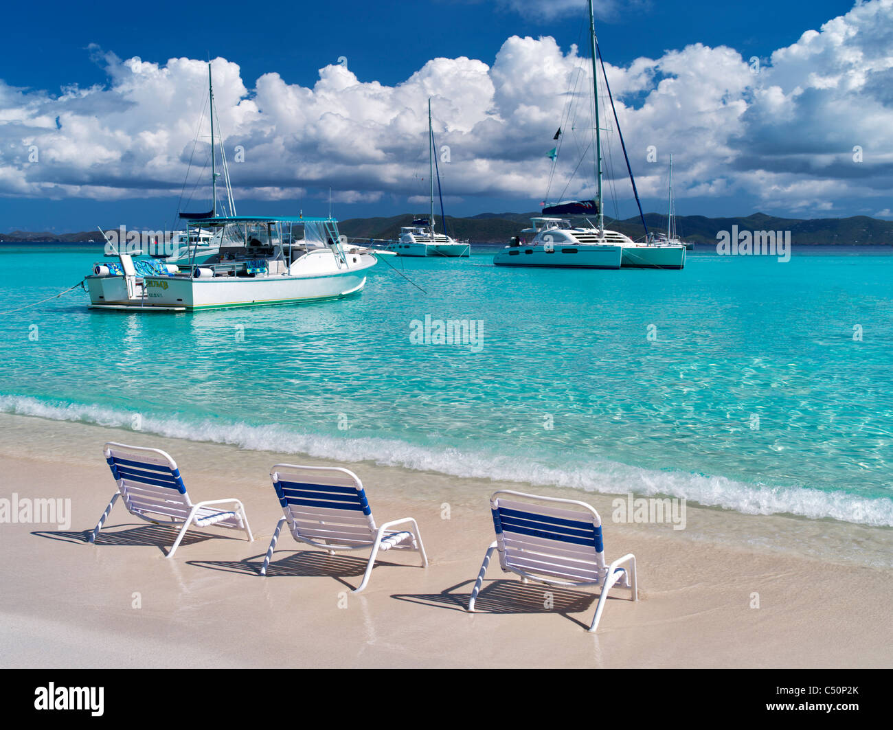 Beach and boats with chairs. Jost Van Dyke. British Virgin Islands - Stock Image
