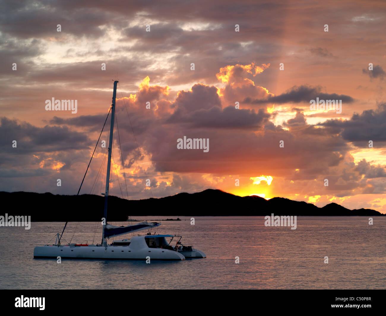 Sailboat off St. John, Virgin Islands and sunset. - Stock Image