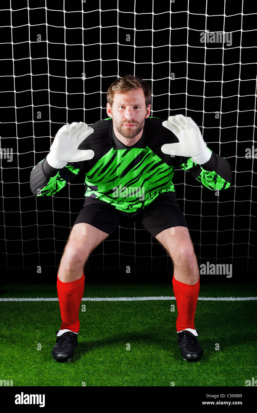 Photo of a goalkeeper facing a penalty kick - Stock Image