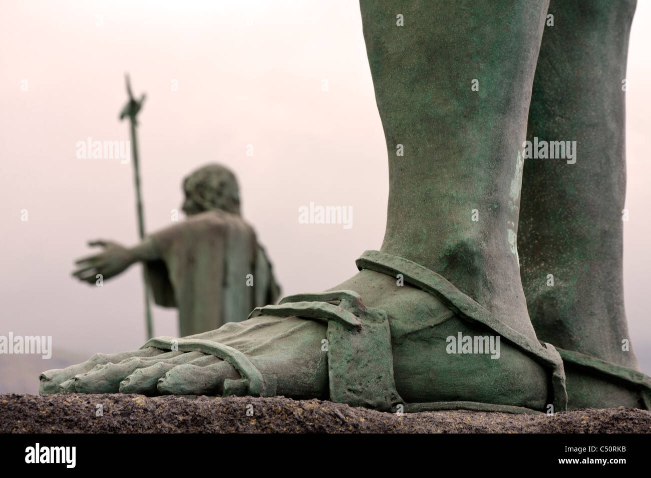 Close up of the left foot of one of the Mencey statues in Candelaria in Tenerife Canary Islands Spain - Stock Image
