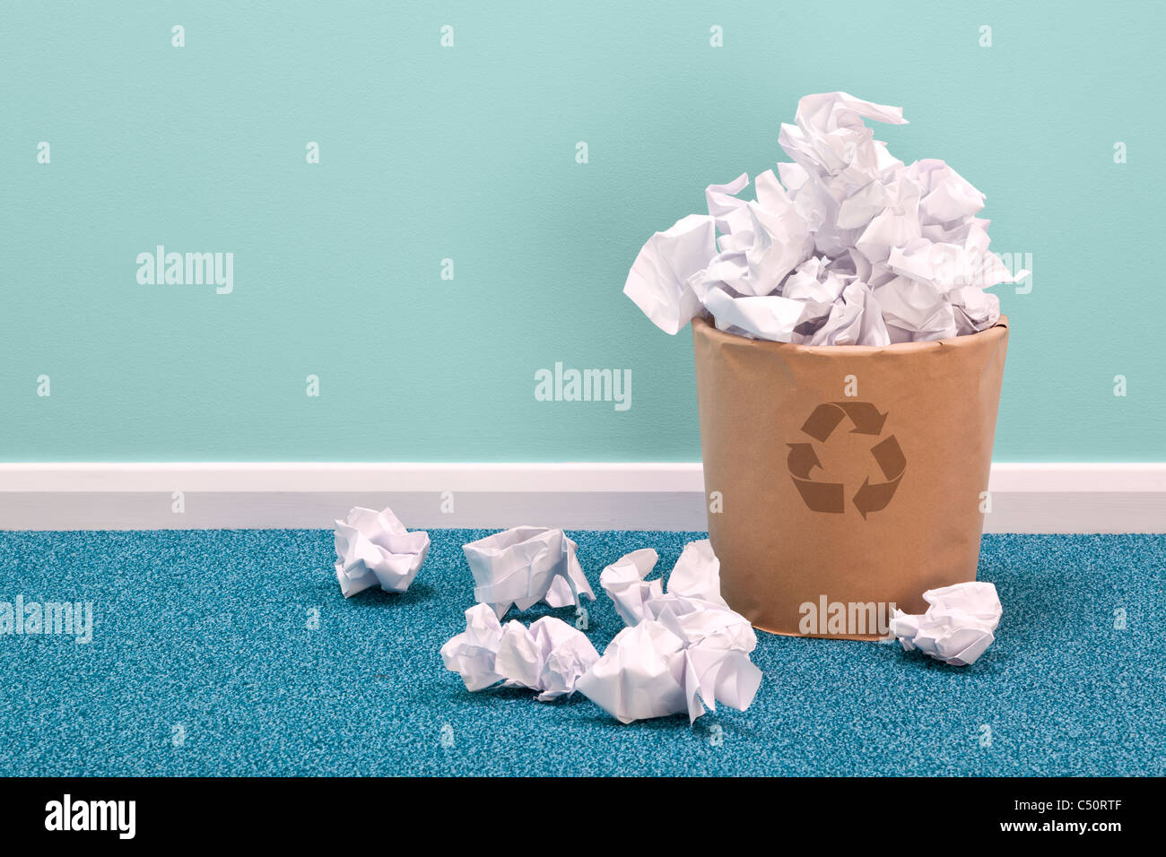 Photo of a recycling waste paper basket on an office floor - Stock Image
