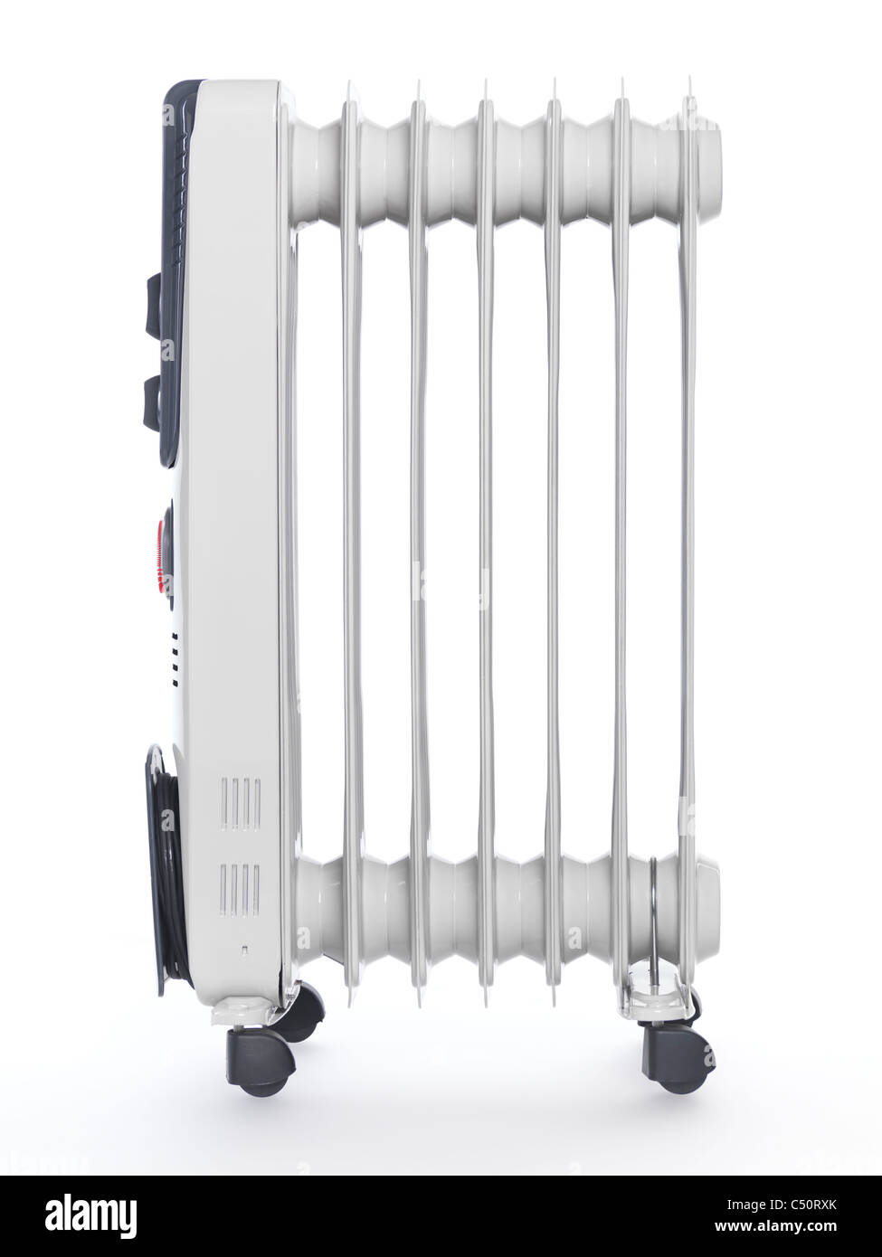 Oil filled air heater. Radiator isolated on white background. - Stock Image