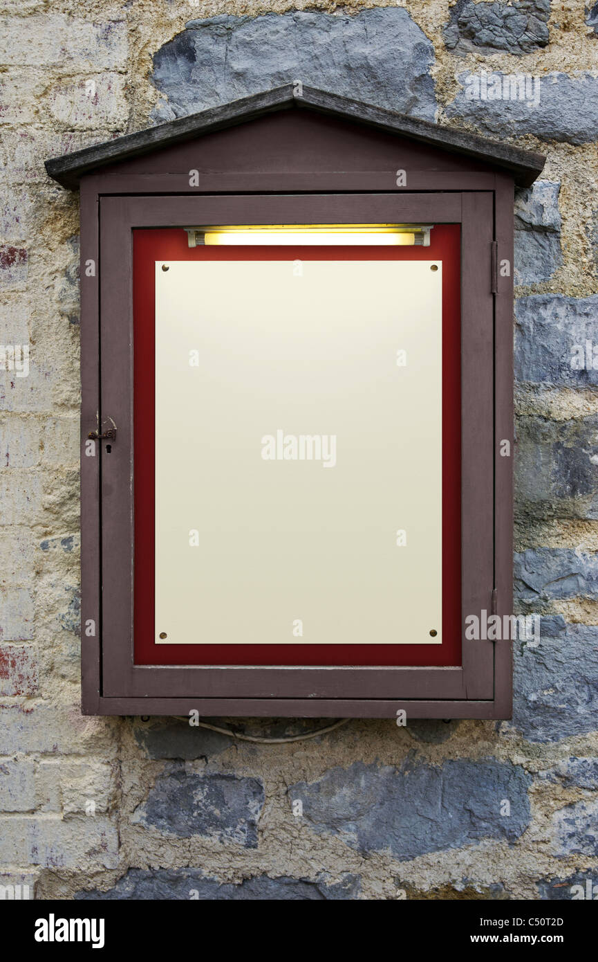 Photo of an old weathered illuminated notice board on a wall, plenty of copy space to add your own text. - Stock Image