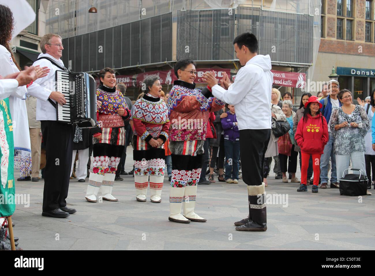 Greenlandic dance group performing in the streets of Copenhagen, Denmark - Stock Image