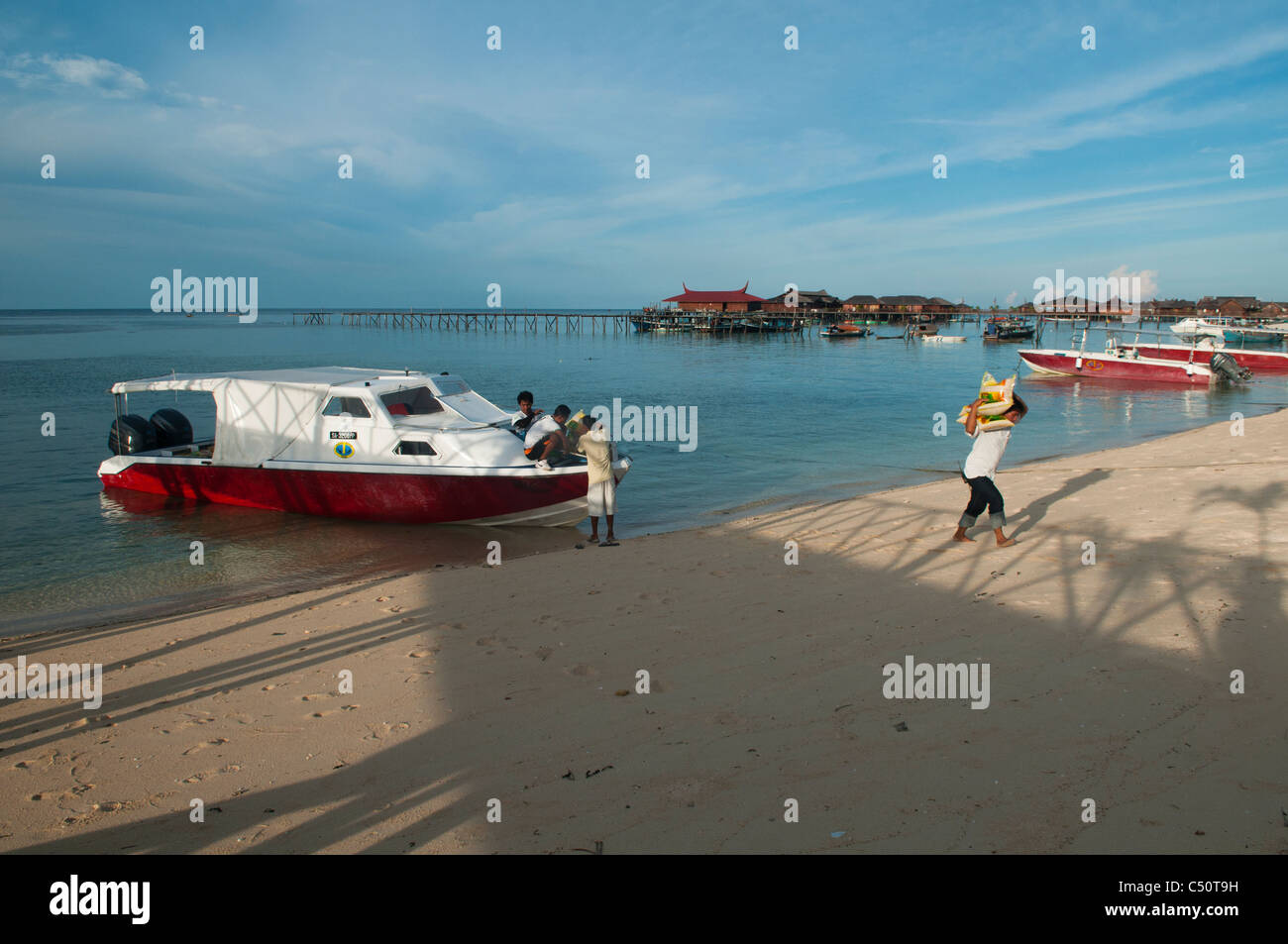 boats on the beach on Mabul Island, Borneo, Malaysia - Stock Image