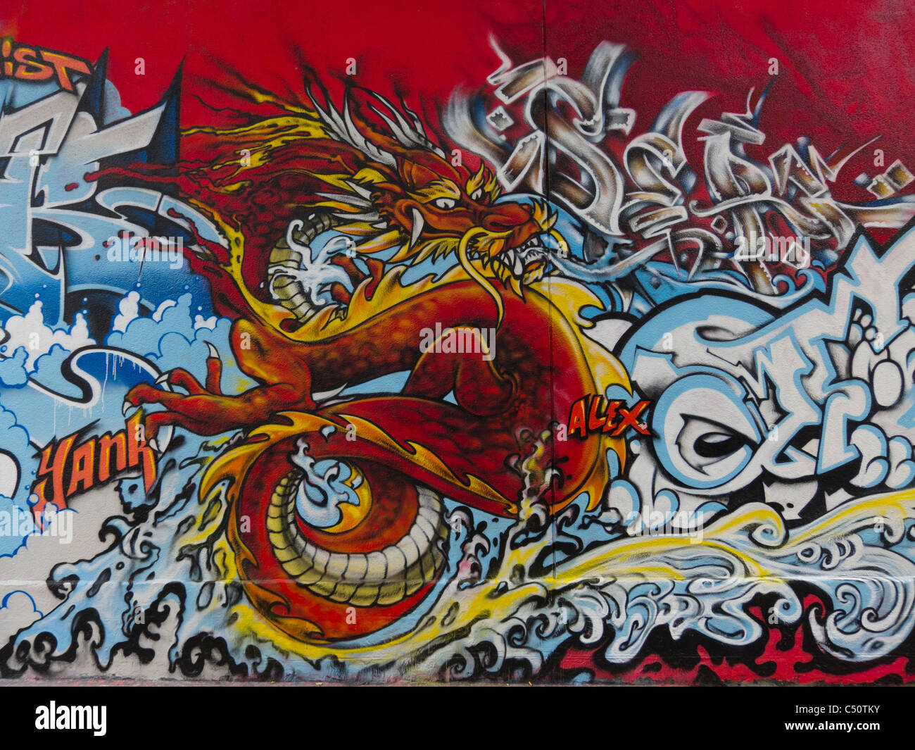 Paris, France, Graffiti Artist's Painting Wall, Asian Graphic Dragon Illustration, Street Art - Stock Image