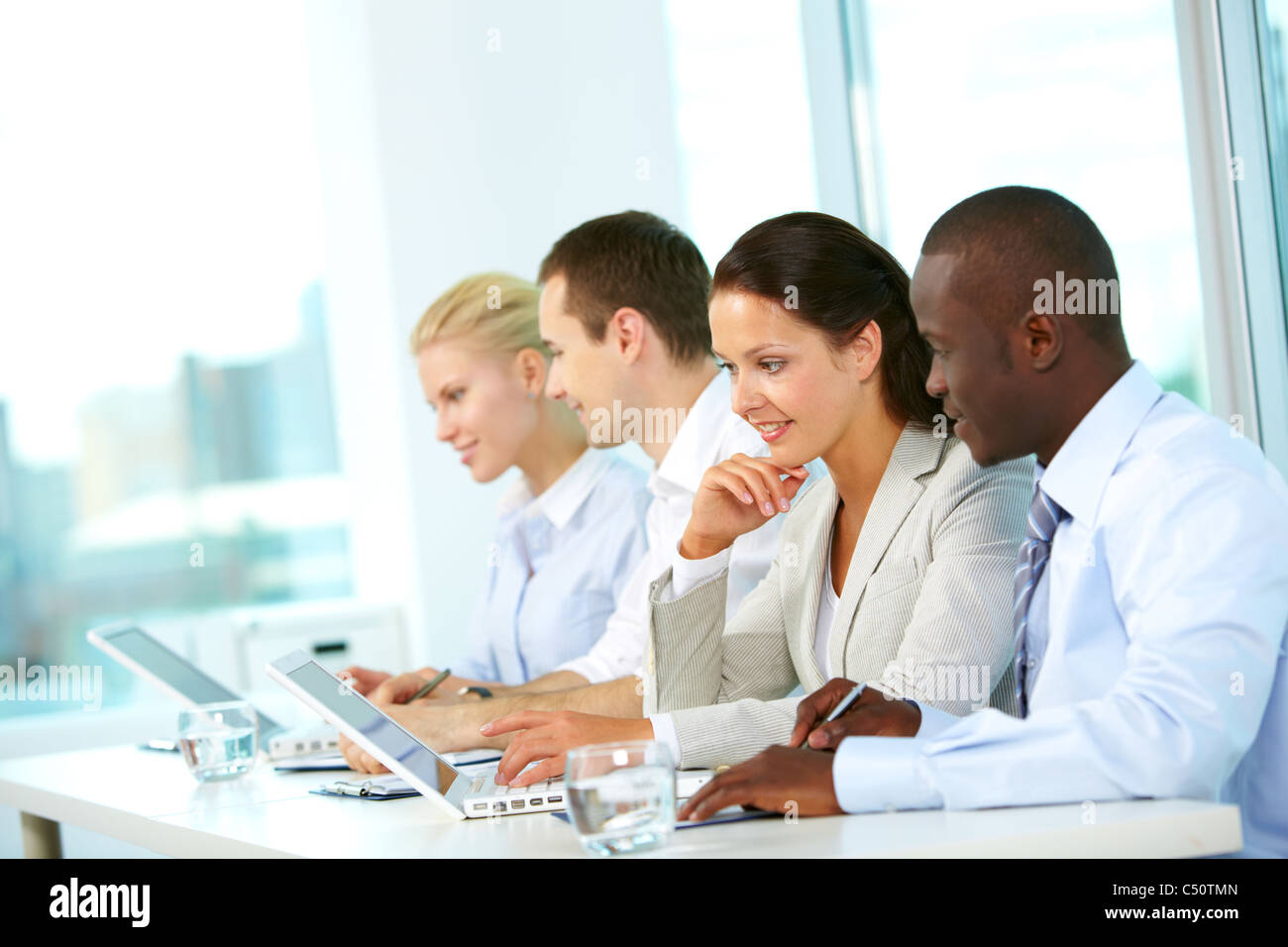 Group of business people planning work in office - Stock Image