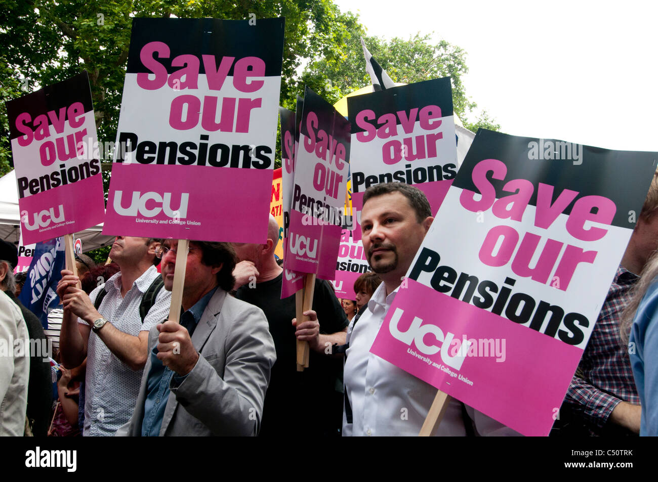 One day strike by teachers and civil servants to protest at changes in pensions- group of members of UCU union with - Stock Image