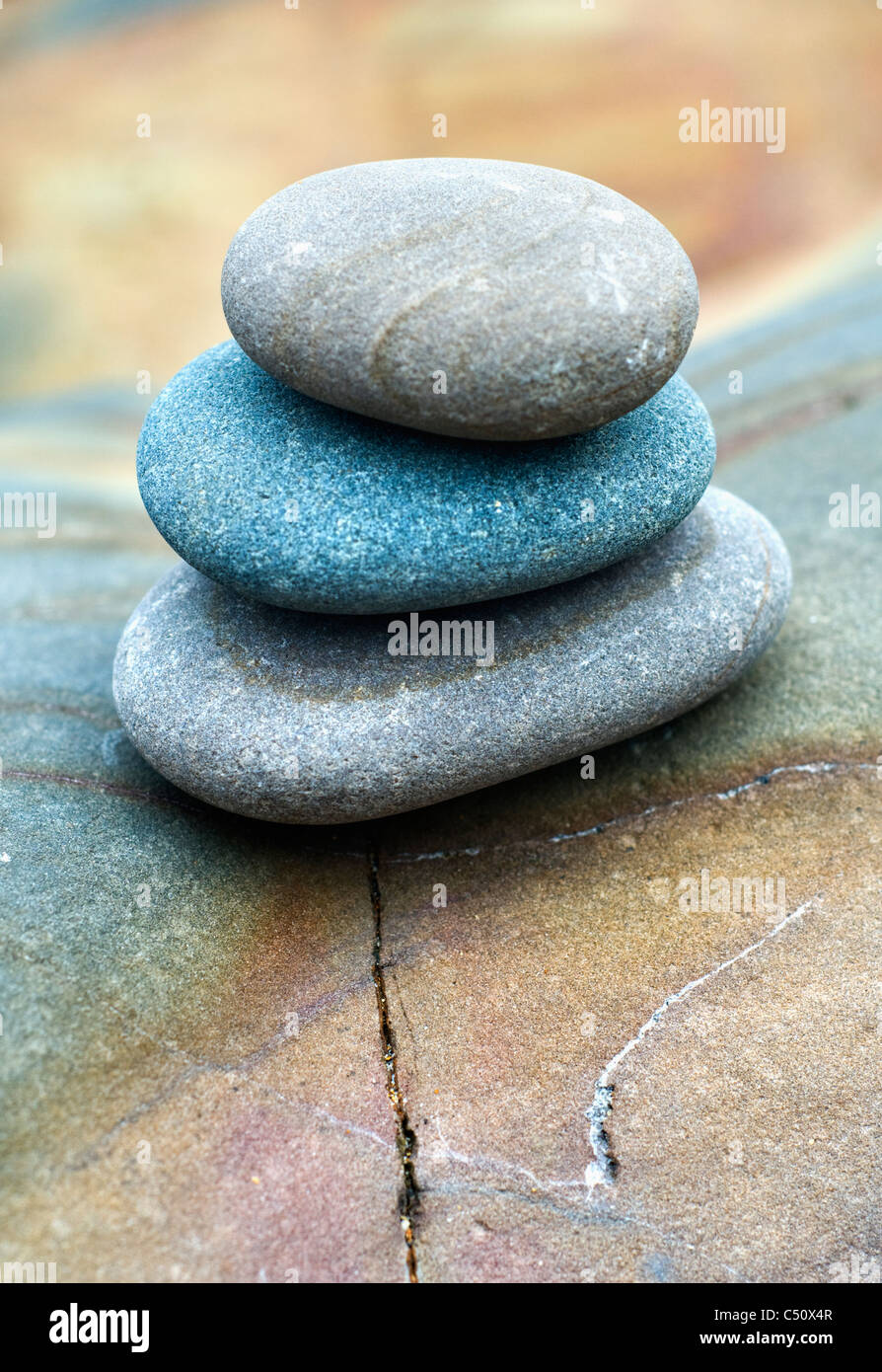 A small pile of pebbles on the beach at Bude in Cornwall, England - Stock Image