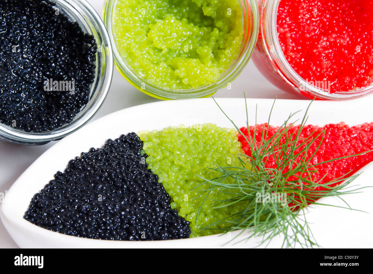 caviar in a jar and in a bowl-shaped over - Stock Image